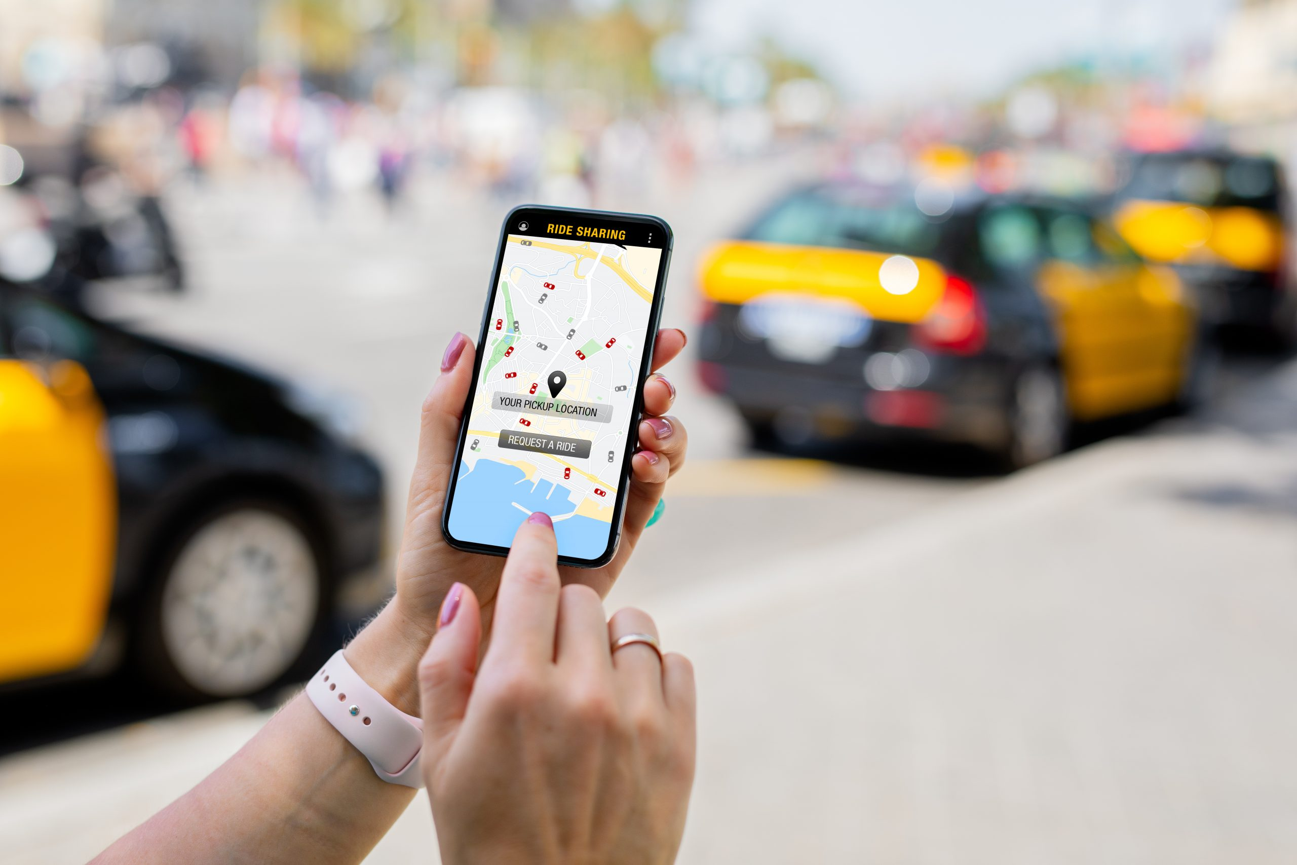 Person using ride sharing app on mobile phone